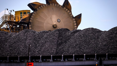 A bucket-wheel reclaimer stands next to a pile of coal at the Port of Newcastle in Newcastle, New South Wales.