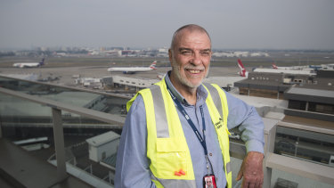 Seen it all: Graeme Brown is the longest-serving employee of Sydney Airport, which celebrates its centenary this month.