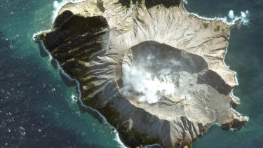 A satellite image provided by Maxar Technologies shows White Island in New Zealand before a volcano erupted.