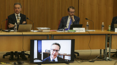 RBA Deputy Governor Guy Debelle appearing by video link at a Senate Estimates Hearing.