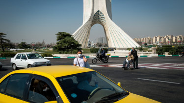 A pedestrian wears a protective face mask in Tehran, Iran.