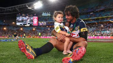 North Queensland Cowboys captain Johnathan Thurston with daughter Frankie after winning the 2015 NRL grand final.