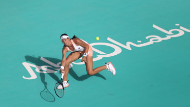 Ajla Tomljanovic of Australia plays a forehand against Aryna Sabalenka of Belarus during her Women's Singles match on Day Three of the Abu Dhabi WTA Women's Tennis Open at Zayed Sports City on January 08, 2021 in Abu Dhabi.