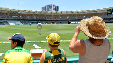 Australian fans watch a test match at the Gabba in November 2019. This week's match up will now only be open to half the capacity.