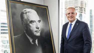 Prime Minister Scott Morrison with a portrait of Liberal Party pioneer Sir Robert Menzies.