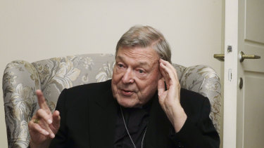 Cardinal George Pell answers a journalist's question during an interview inside his residence near the Vatican in Rome.