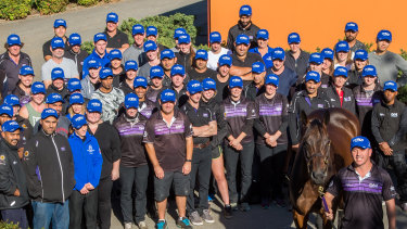 Time to say goodbye: Winx with the staff at Chris Waller's stable on Thursday.