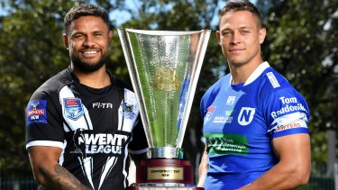 Newtown's Scott Sorenson and Wentworthville's Josh Hoffman with the Canterbury Cup. Tom Raudonikis can be seen on the Newtown sleeve.