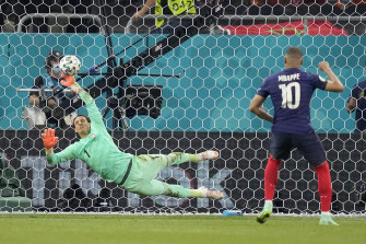 Yann Sommer saves Kylian Mbappe's penalty attempt to put Switzerland into the last eight at Euro 2020.