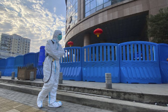 A worker with disinfecting equipment outside Wuhan Central Hospital in February.