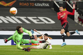 Mason Greenwood scores United's sixth and final goal against Roma.