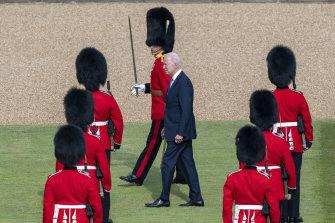 US President Joe Biden inspects the ranks of a Guard of Honour.