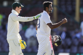 Tim Paine congratulates Ravi Ashwin at stumps.