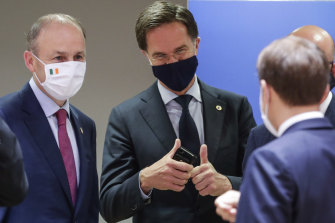 Dutch Prime Minister Mark Rutte, centre, gives the thumbs up as he speaks with French President Emmanuel Macron, right, and Irish Prime Minister Micheal Martin, left, at the Brussels summit on Tuesday.