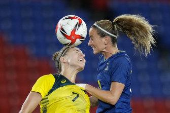 Steph Catley (left) and Sweden's Kosovare Asllani contest the ball.