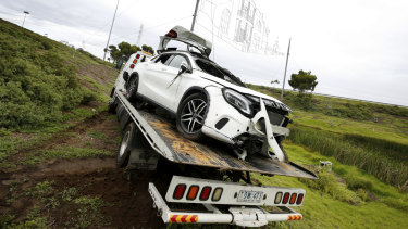 A tow truck being used to move the white Mercedes became bogged on Sunday morning.