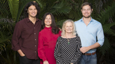 Marina Go in red, with her sons Lachlan (left) and Jackson (right) and mother Maria.