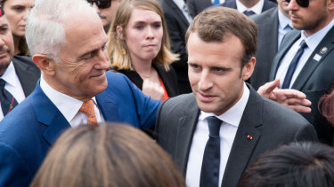 Prime Minsiter Malcolm Turnbull and French President Emmanuel Macron, meet veterans and their families at the commemoration ceremony .