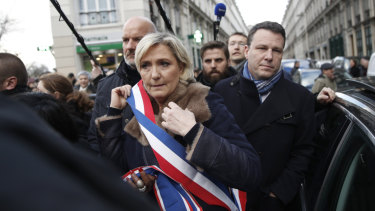 French far-right leader Marine Le Pen arrives at the march.