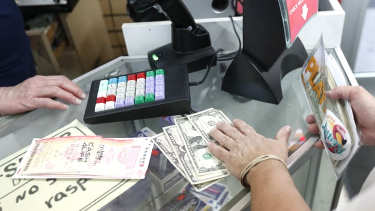 A customer purchases lottery tickets at La Preferida Superdiscount store in Hialeah, Florida.