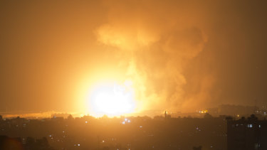 An explosion from Israeli airstrikes hits Gaza City early on Thursday.
