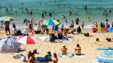 Beachgoers flock to Newcastle's Bar Beach on Friday morning.