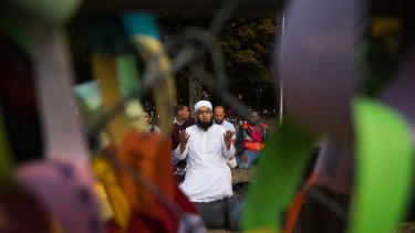 Mufti Zeeyad Ravat from Melbourne leads the crowd in a prayer near the Al Noor Mosque in Christchurch.
