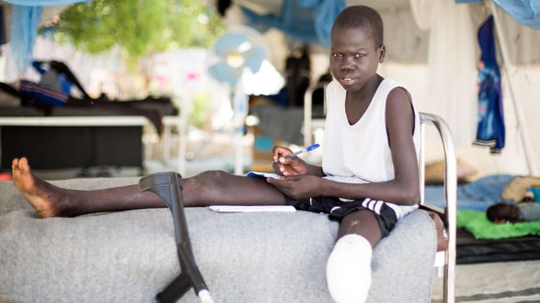 Nine-year-old Gatwec Riat was shot in clashes between government and rebel forces. Dorsa arranged his evacuation to a Red Cross mobile surgical team, who had to amputate his leg.