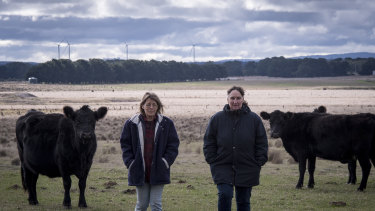 Neighbours Michelle Evans (left) and Janene Skidmore will each have wind turbines about a kilometre from their back fences in Mount Wallace. An existing wind farm is already in operation nearby.