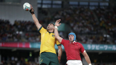 Australia's Rory Arnold, left, leaps above Wales' Justin Tipuric to win a lineout at last year's Rugby World Cup.