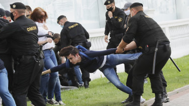 Police officers detain protesters during a protest rally against the removal of opposition candidates from the presidential elections in Minsk on July 14.