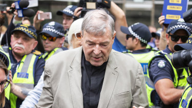 Cardinal George Pell leaves Melbourne's County Court after his guilty verdict was made public.