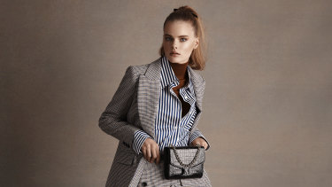 "Claudie Pierlot jacket, $715, and skirt, $430. Anna Quan ""Lesley"" shirt, $340. Max Mara skivvy, $665, belt bag, $1230, and boots (not shown), $1720."