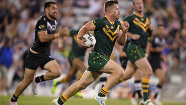 Kangaroos hooker Damien Cook bursts clear to score against New Zealand in Wollongong on Friday night.