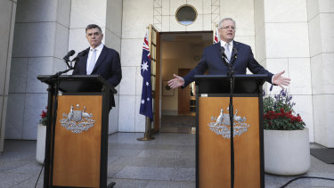 Chief Medical Officer Professor Brendan Murphy and Prime Minister Scott Morrison practised social distancing at their press conference on Wednesday.