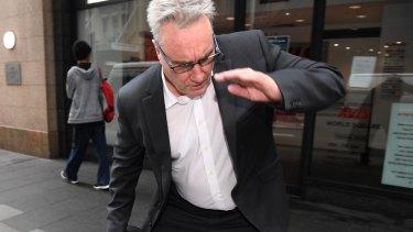 ATO deputy commissioner Michael Cranston, the father of Adam Cranston, outside Central Local Court in Sydney in  2017.
