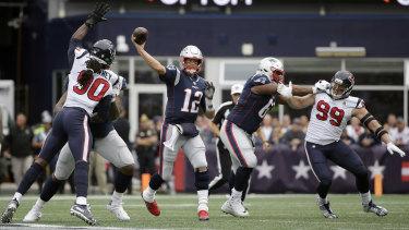 New England Patriots quarterback Tom Brady throws under pressure against the Texans.