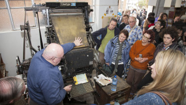 Laurie Harding demonstrates the operation of a Linotype machine at the 2009 fundraiser for the museum.
