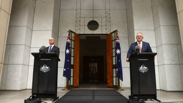 Prime Minister Scott Morrison and Chief Medical Officer Paul Kelly on Friday.