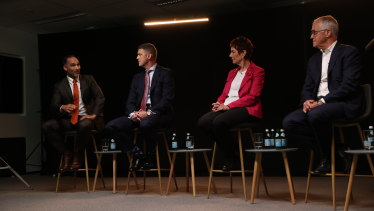 McGrathNicol senior risk adviser John Garnaut (far left) speaks at a panel with his former boss Malcolm Turnbull (right).
