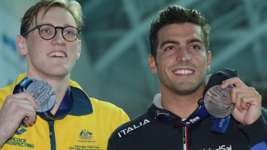 Australia's Mack Horton, left, holds his silver medal with bronze medallist Italy's Gabriele Detti after refusing to stand on the podium with the gold medal winner China's Sun Yang