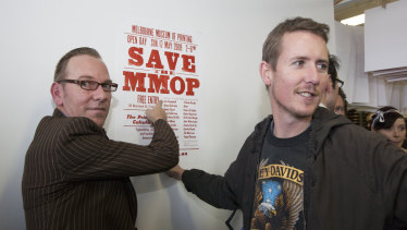 """Print-based artist Jon Campbell, left, at the 2009 """"Save the MMoP"""" fundraiser."""