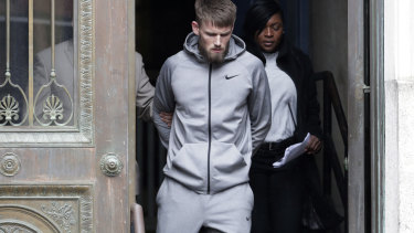 Mixed martial arts fighter Cian Cowley, a friend of Conor McGregor, is led away by police.