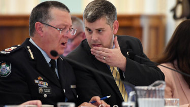 Queensland Police Commissioner Ian Stewart (left) with Queensland Police Minister Mark Ryan at estimates hearings this week.
