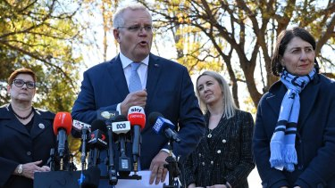 Prime Minister Scott Morrison and NSW Premier Gladys Berejiklian address the media in Richmond on Monday.