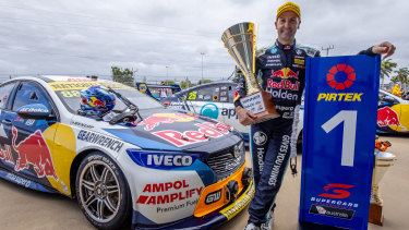 Jamie Whincup of the Red Bull Holden Racing Team celebrates after winning race 20 during the Townsville SuperSprint.