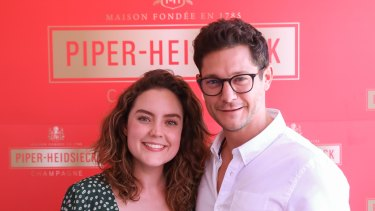 Georgie Tunny and Rob Mills in the Piper-Heidsieck tent at the Australian Open on Thursday.