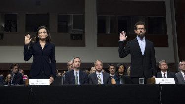 Facebook COO Sheryl Sandberg, left, accompanied by Twitter CEO Jack Dorsey at a Senate hearing