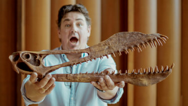 UQ PhD researcher Tim Richards with a reconstruction of Thapunngaka shawi's skull.