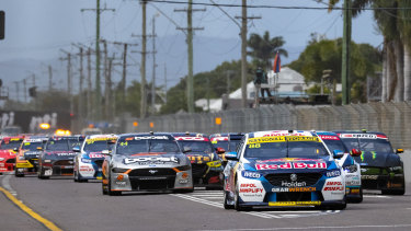 Jamie Whincup leads the field during race 20 in Townsville.